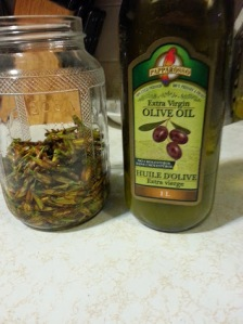 Fill the jar with the olive oil.  Let soak for a few weeks.  Shake every day to mix well.